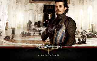orlando bloom in three musketeers action movie poster